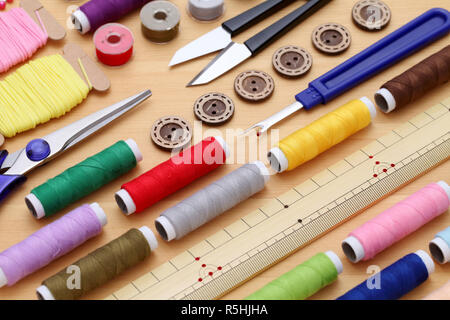 sewing tools, tailoring and fashion concept - close-up on wooden table - Stock Photo