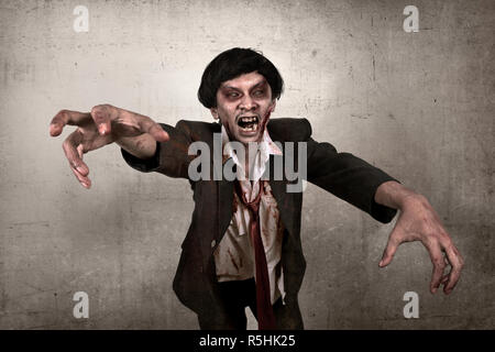 Scary asian zombie man with bloody face - Stock Photo