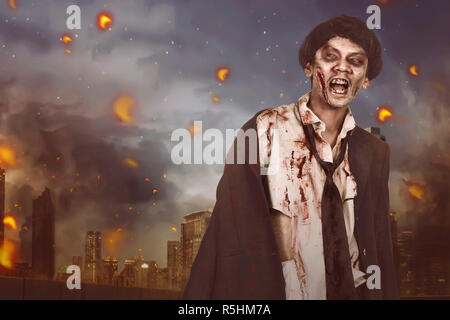 Portrait of horrible asian zombie man with suit - Stock Photo