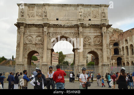 Rome, Italy-October 07, 2018. A large crowd of tourists near the arch of Constantine and the Colosseum, the sights of Rome - Stock Photo