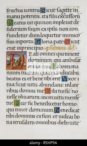 Text page with initial 'D'. Mirandola Hours. Italy, circa 1490-1499. [Whole folio] Text page from the Hours of the Virgin. End of Psalm 126; Psalm 127 with initial 'D' [B], formed of branches against a scenic background Image taken from Mirandola Hours. Originally published/produced in Italy, circa 1490-1499. Source: Add. 50002, f.39. Language: Latin. - Stock Photo