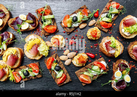 many different types of snacks on the table - Stock Photo
