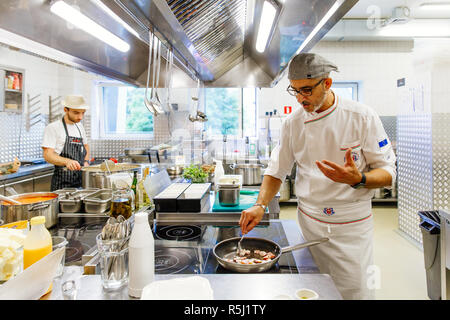 Moscow, Rusisia, 05.08.2018: our chef is cooking in the kitchen - Stock Photo