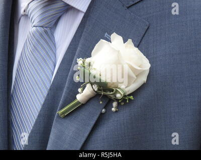 White rose on the lapel of a bridegroom - Stock Photo