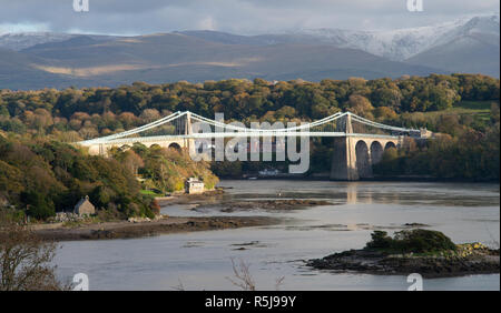 Menai suspension bridge, crossing the Menai Straits, connecting the Welsh mainland with The Isle of Anglesey. Image taken in October 2018. - Stock Photo