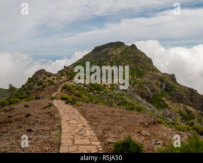 Hiking trail from Pico Ruivo to Pico Arieiro through the volcanic mountain range of the island of Madeira, Portugal - Stock Photo