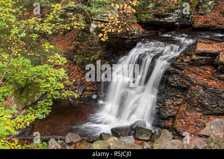 Big Run Falls splashes down a cliff in northeastern Pennsylvania on an autumn day. - Stock Photo