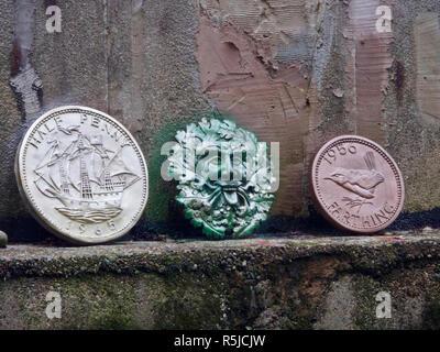 Green Man Deity Plaque & Large Replica British Half Penny & Farthing Coins, UK - Stock Photo