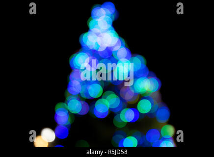 Christmas tree multicoloured lights, blurred to give an abstract effect. - Stock Photo