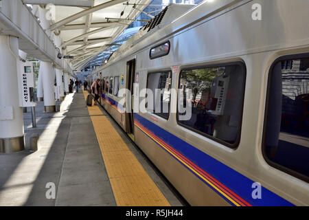 Light rail train at Union Station in downtown Denver which goes to Denver International Airport, Colorado, USA - Stock Photo