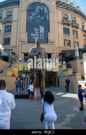 Johannesburg, South Africa, 1st December 2018.  People take pictures of themselves with the Nelson Mandela statue in Nelson Mandela Square in Sandton. South Africa is currently celebrating the centenary of Madiba's birth. Credit: Eva-Lotta Jansson/Alamy Live News - Stock Photo