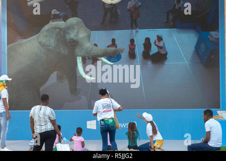 Johannesburg, South Africa, 1st December 2018. Children play with an interactive digital display in Nelson Mandela Square in Sandton, as part of Global Citizen Festival: Mandela 100. South Africa is currently celebrating the centenary of Madiba's birth. Credit: Eva-Lotta Jansson/Alamy Live News - Stock Photo
