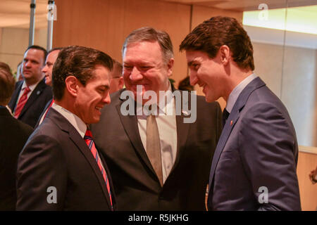 Buenos Aires, Argentina. 30th November, 2018. U.S. Secretary of State Mike Pompeo, center, chats with Mexican President Enrique Pena Nieto, left, and Canadian Prime Minister Justin Trudeau after the signing ceremony for the new NAFTA trade agreement known as USMCA November 30, 2018 in Buenos Aires, Argentina. Credit: Planetpix/Alamy Live News - Stock Photo