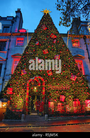 London, UK. 1st December 2018. Giant Christmas tree decoration covering the whole of the front of the building outside Annabel's Club in Berkeley Square, London, UK Credit: Paul Brown/Alamy Live News - Stock Photo