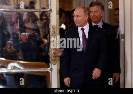 Buenos Aires City, Argentina. 01st Dec, 2018. Argentinian President Mauricio Macri (back) welcomes Russian President Vladimir Putin during a meeting at the Casa Rosada, in Buenos Aires, Argentina, 01 December 2018. Credit: Juan Ignacio Roncoroni/EFE/Alamy Live News - Stock Photo