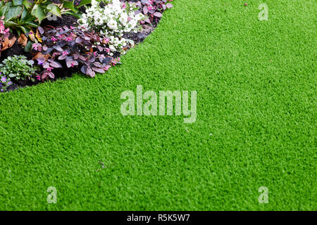 maintenance free artificial turf  lawn a modern synthetic grass carpet - Stock Photo