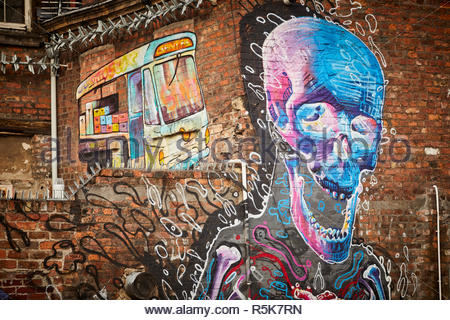 Liverpool city centre  Street art Graffiti mural of Skeleton skull and milk float near Bold Street on brick walls - Stock Photo