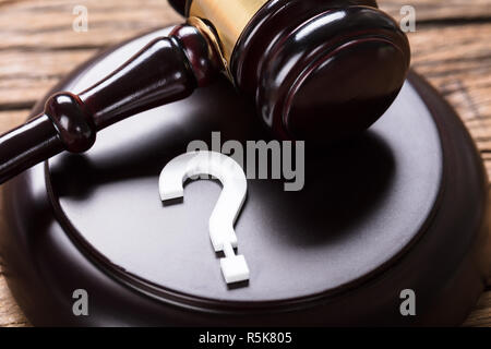 Question Mark And Auction Gavel - Stock Photo
