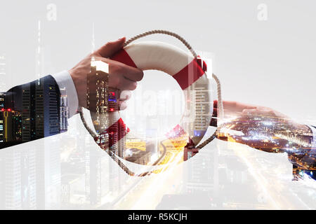 Close-up Of A Male's Hand Holding Lifebuoy - Stock Photo