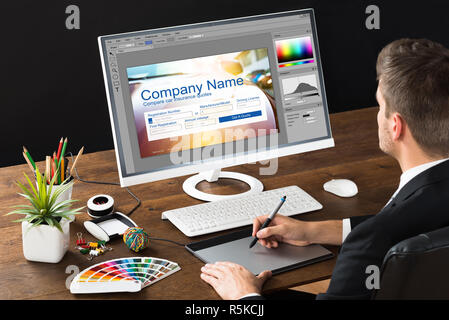 Photo Editor Using Graphic Tablet - Stock Photo