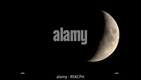 Waxing crescent moon seen with telescope - Stock Photo