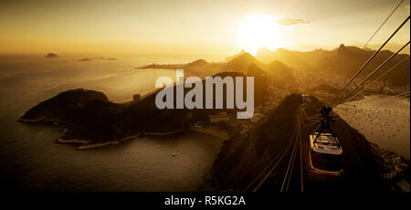 Aerial View of Rio de Janeiro from the Sugarloaf Mountain by Sunset, Brazil - Stock Photo
