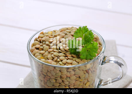 dry brown lentils - Stock Photo