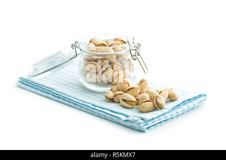 Pistachio nuts in jar. - Stock Photo