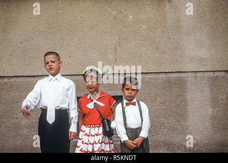 Siblings at Older Brother's First Communion, USA, 1956 - Stock Photo