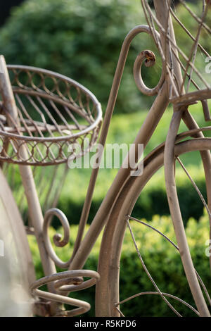 Bicycle rack as decoration for the garden - Stock Photo