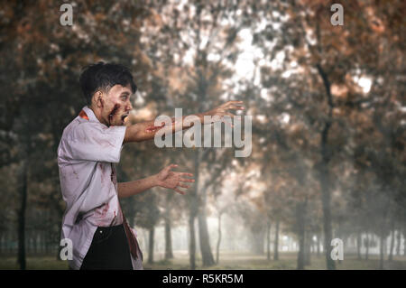 Scary asian zombie man with wounded face - Stock Photo