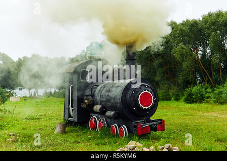 the smoke in the sky from the steam locomotive - Stock Photo