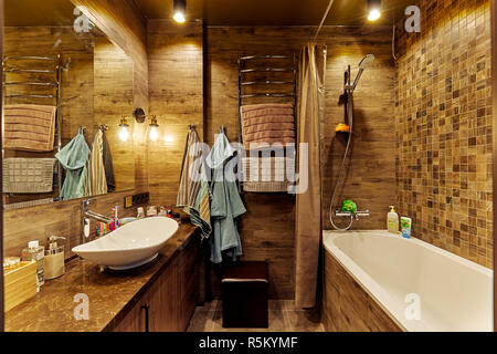 Eindhoven, The Netherlands - December 19, 2018: Interior of a contemporary bathroom with bathtub, in natural earth colors.