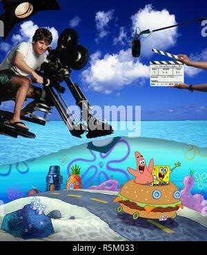 RELEASE DATE: November 19, 2004. MOVIE TITLE: Spongebob Squarepants the Movie. STUDIO: Paramount Pictures. PLOT: There's trouble brewing in Bikini Bottom. Someone has stolen King Neptune's crown, and it look like Mr. Krab, SpongeBob's boss, is the culprit. Though he's just been passed over for the promotion of his dreams, SpongeBob stands by his boss, and along with his best pal Patrick, sets out on a treacherous mission to Shell City to reclaim the crown and save Mr. Krab's life. PICTURED: STEPHEN HILLENBURG on the set. Original film title: THE SPONGEBOB SQUAREPANTS MOVIE. English title: THE  - Stock Photo