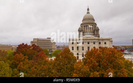 Its an overcast day but the aerial view shows color in the Autumn leaves in Providence RI - Stock Photo