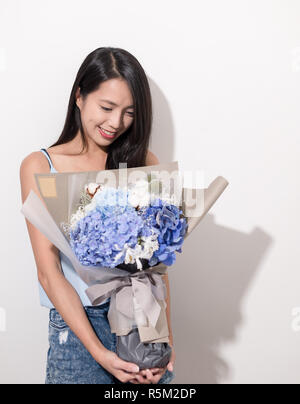 Woman holding flower - Stock Photo