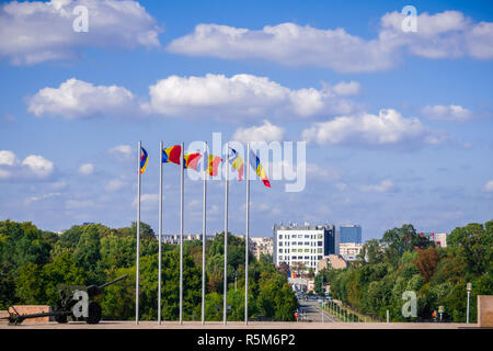 Romanian national flags waving in the wind on top of the hill in Carol Park, Bucharest, Romania - Stock Photo