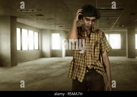 Scary asian zombie man with wounded face standing - Stock Photo