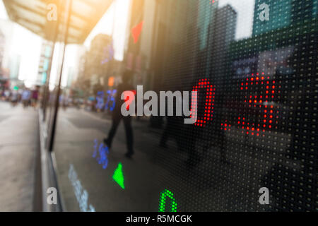 Stock market display in the evening - Stock Photo