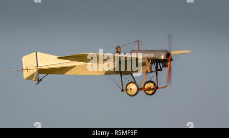 Biggleswade, UK - 6th May 2018:  A Flying replica of a Deperdussin1910 in flight at the Shuttleworth Collection. - Stock Photo