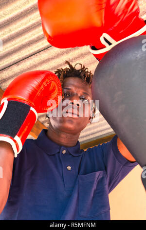 Attractive young black man very handsome practicing boxing - Stock Photo
