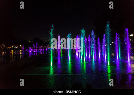 Brightly and colorfully lit fountain in Plovdiv, Bulgaria. - Stock Photo
