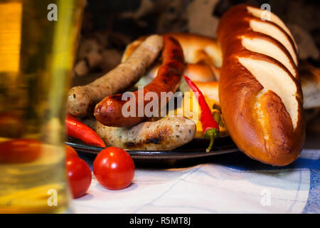 Bavarian White And Red Sausages With Mustard, Bavarian Buns and Pretzels At The Table. October Fest Concept - Stock Photo