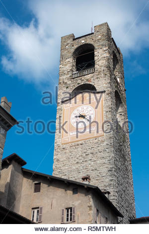 BERGAMO, LOMBARDY/ITALY - JUNE 26 : Civic Tower (Campanone - Big Bell) and Palazzo Del Podestaore in Bergamo on June 26, 2017 - Stock Photo