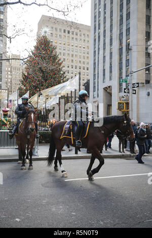 NYPD Mounted Unit police officer provides security at Rockefeller Plaza in Midtown Manhattan - Stock Photo