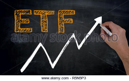 etf and graph is written by hand on blackboard - Stock Photo