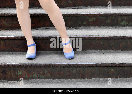 beautiful female feet in heel shoes on the stairs - Stock Photo