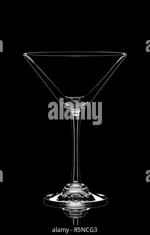 Transparent empty glass of martini isolated on black background - Stock Photo