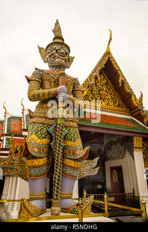 Thai Warrior Statue stands guard at the Grand Palace in Bangkok, Thailand. - Stock Photo