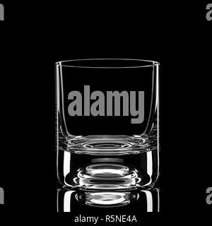 Transparent empty glass of whiskey isolated on black background - Stock Photo